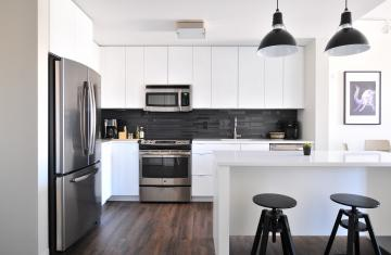 stainless steel appliances in modern apartment