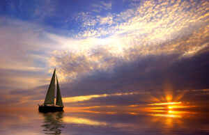 SailBoat on calm water with sunset