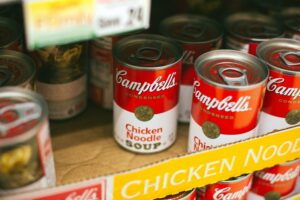 cans of soup in a box