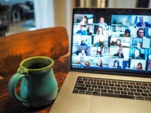 laptop with video chat open working from home